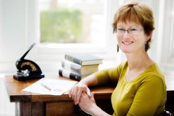 Rowena sat at desk image